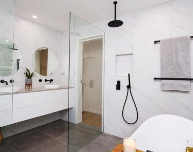 black accessories with a white bathroom