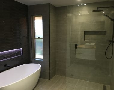 bathroom with dark tiles