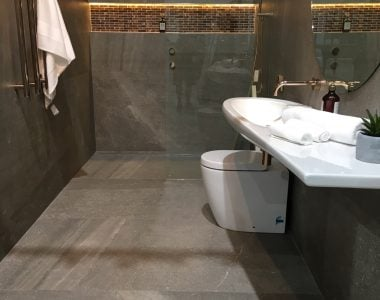 bathroom with gray tile with touches of white