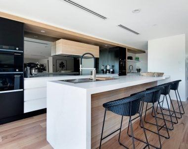 modern kitchen and kitchen counter with for black counter chairs